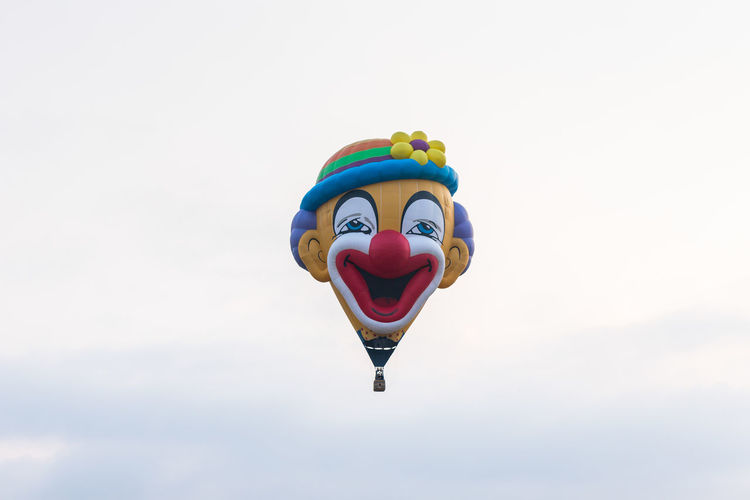 Afula, Israel, 3 August, 2018 : In the sky hot air balloon in the shape of a clown's head at the hot air balloon festival Construction Flame Fly Gas Passenger Shape Sky And Clouds Transport Trip Aircraft Aviation Equipment Festival Of Air Hot Balloons Fire Israel People Pilot Preparing Sport Technician Technology Tool Travel Destinations Vacation Warm