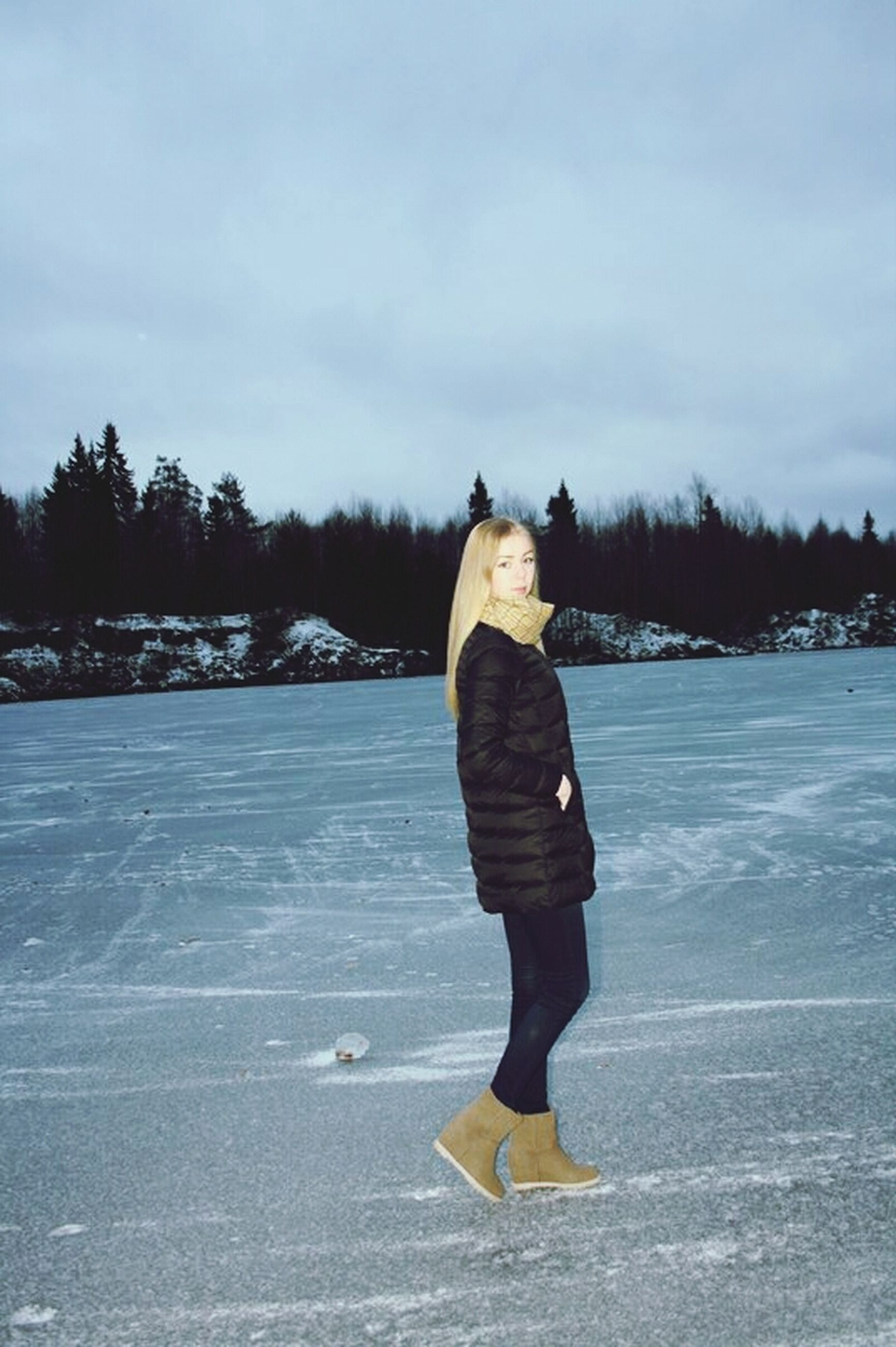 snow, winter, cold temperature, season, lifestyles, full length, leisure activity, rear view, weather, standing, sky, warm clothing, tree, casual clothing, transportation, day, nature, outdoors