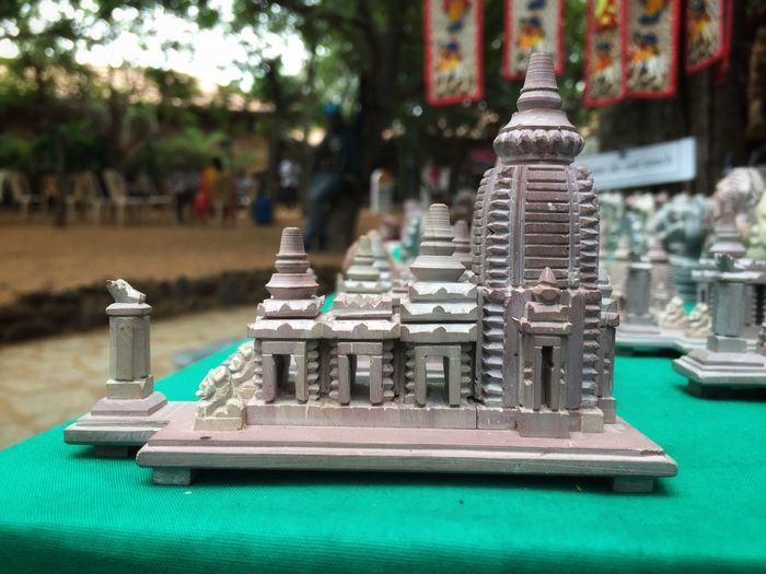 Miniature photography... Sculpture Photography Sculpture Miniature Focus On Foreground Close-up Day No People Table Architecture Outdoors Religion Spirituality Built Structure Belief Antique Place Of Worship Art And Craft Building Exterior City