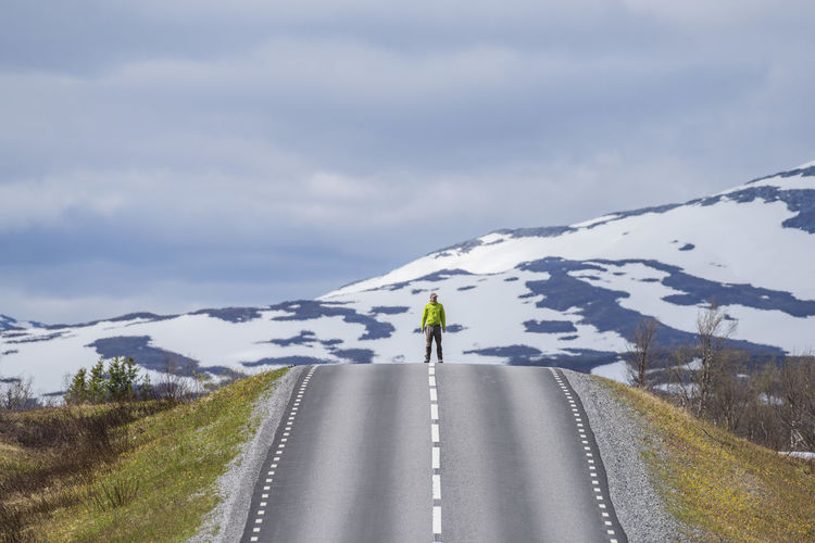 One Man Only One Person Adults Only Adult Mountain People Outdoors Day Sky Road Snow Adventure Nature Headwear Sweden Scenics Planet Earth Beauty In Nature Cloud - Sky Wilderness Area Getting Away From It All Nature Roadtrip Roads Road To Nowhere