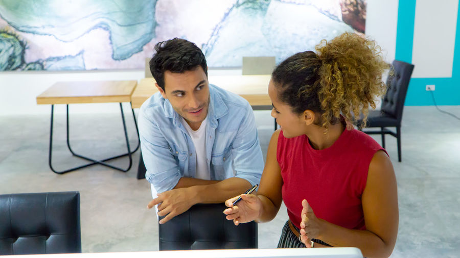 Businesswoman and businessman working together in office