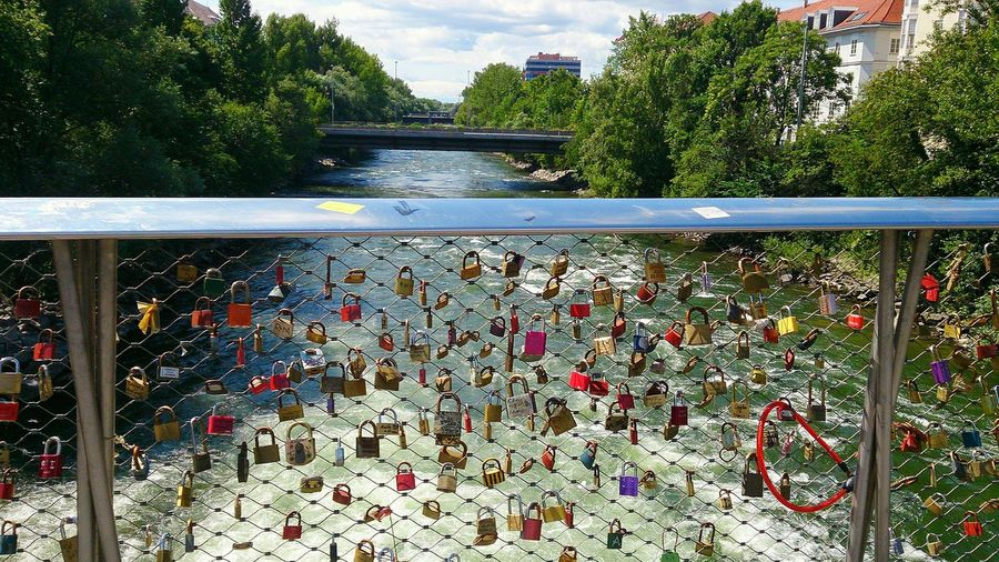I was here ,view of love padlocks on the bridge of Hauptbruecke, Graz, Austria Padlocks Sky Water River Austria Graz bridge Love Love ♥ Fence Break The Mold EyeEmNewHere Romantic❤ The Photojournalist - 2017 EyeEm Awards The Street Photographer - 2017 EyeEm Awards