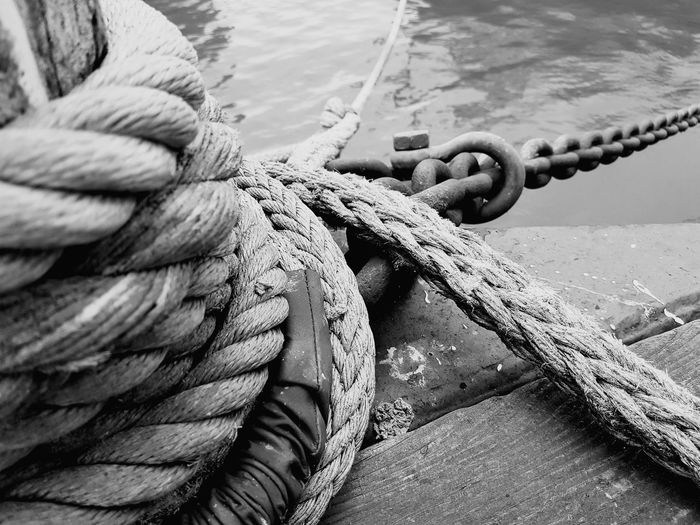 High angle view of ropes tied on pier