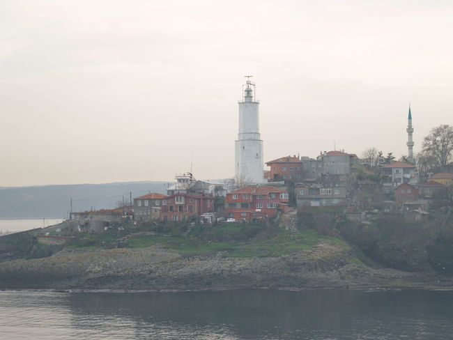 Turkey trip Architecture Building Exterior Built Structure Coastline Direction Guidance In Front Of Lighthouse Mountain Nature No People Outdoors Protection Riverbank Safety Scenics Sea Security Sky Tower Town Tranquil Scene Tranquility Water Waterfront