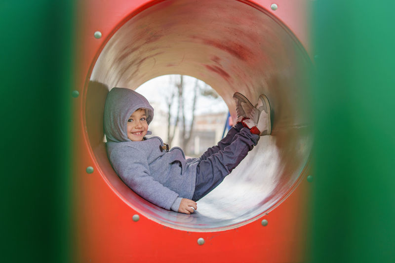 Portrait of smiling boy playing in playground