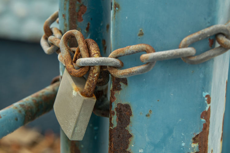 Close-up of lock with chain on pole