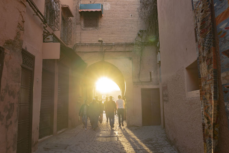 Architecture Building Built Structure Marrakech Marrakesh Morocco Marrakech Morocco Light Light And Shadow Backlit Archway Medina Shillouette Late Afternoon Golden Hour Walking Street Street Photography Red Brick Red Brick Wall Red Brick Building Sunlight Lens Flare Old City City Walls
