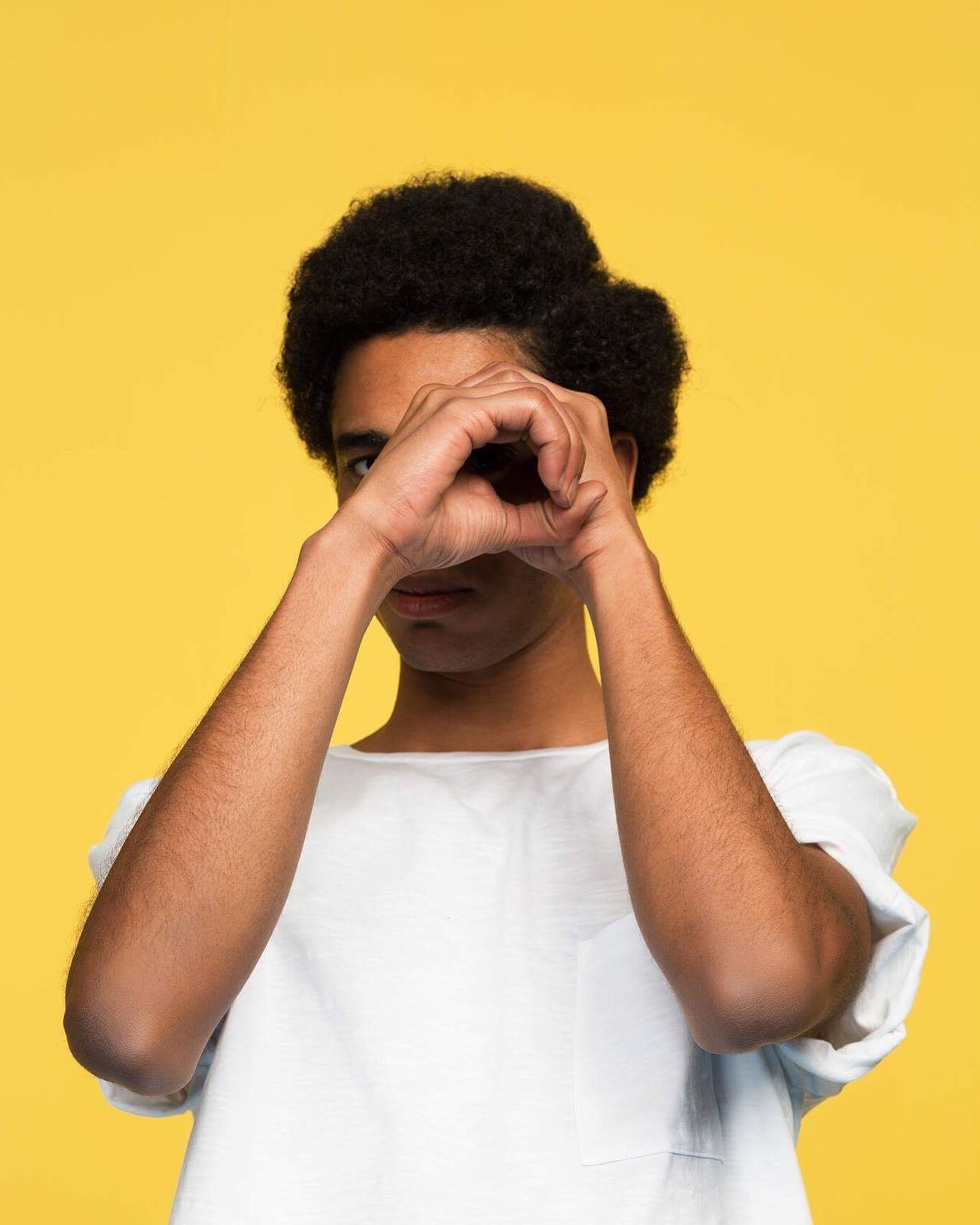 yellow, one person, front view, casual clothing, tensed, real people, young men, yellow background, young adult, men, studio shot, head in hands, lifestyles, white background, indoors, human hand, day, close-up, people