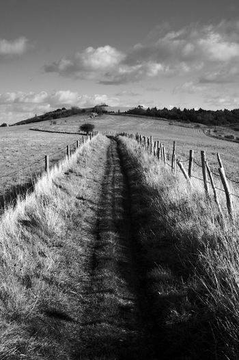 The Path Onwards Sky Cloud - Sky Land Tranquil Scene Environment Tranquility Nature Field Grass Plant Scenics - Nature Landscape Boundary Fence Barrier Beauty In Nature No People The Way Forward Day Direction Outdoors Diminishing Perspective South Downs Blackandwhite Black And White
