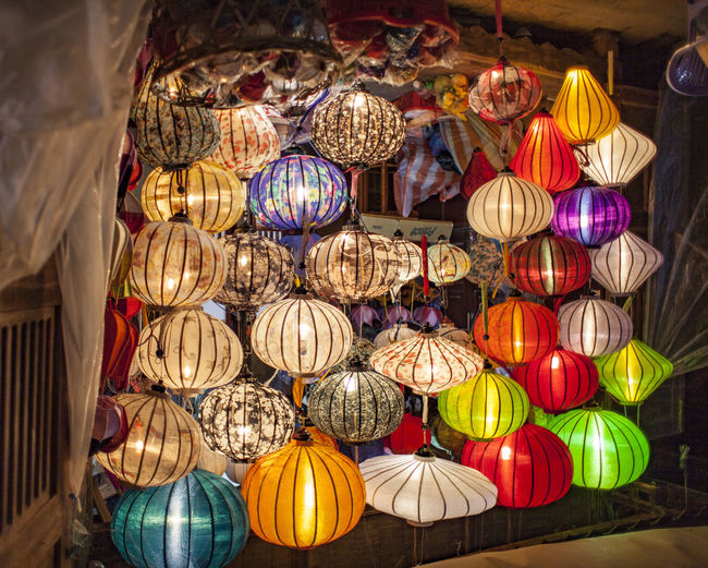 Low angle view of illuminated lanterns hanging on ceiling