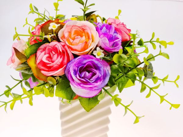 Bright colored flowers in vases Bright Colored Flowers Vases Flower Rose - Flower Pink Color Bouquet Flower Head Petal Leaf Plant Nature Beauty In Nature Freshness Close-up Fragility Indoors