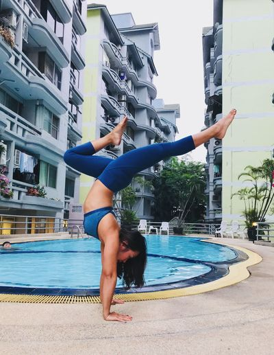 Yogapose Fitness Yoga Architecture Built Structure One Person Full Length Lifestyles Leisure Activity Building Exterior Real People City Jumping Adult Motion Young Adult Human Arm Swimming Pool Healthy Lifestyle Day Vitality Nature Sport