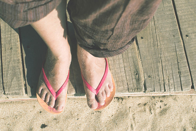 Feet Feets Beach Sand Summer Summertime Wooden Boards Vacations Low Section Human Body Part Body Part Human Leg Lifestyles Real People Leisure Activity barefoot Day Human Foot Shoe High Angle View One Person Women Sunlight Nature Outdoors Footpath Standing Jeans Slipper  Human Limb