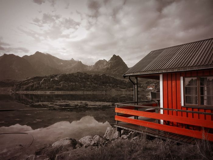 Lofoten Islands Norway Architecture Beauty In Nature Black And Red Colour Building Exterior Built Structure Cloud - Sky Lake Mode Of Transportation Mountain Mountain Range Nature Nautical Vessel No People Reflection Scenics - Nature Sky Tranquil Scene Tranquility Transportation Water