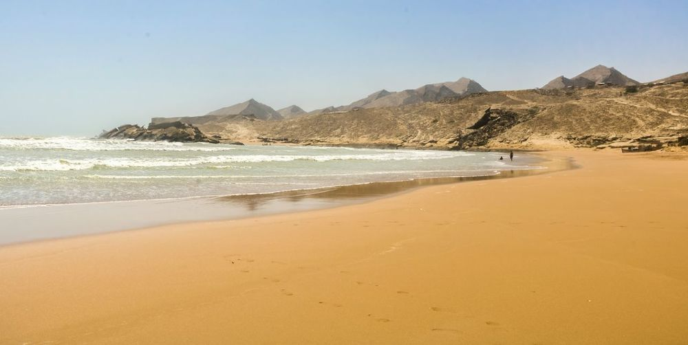 Scenic view of sunny beach in pakistan