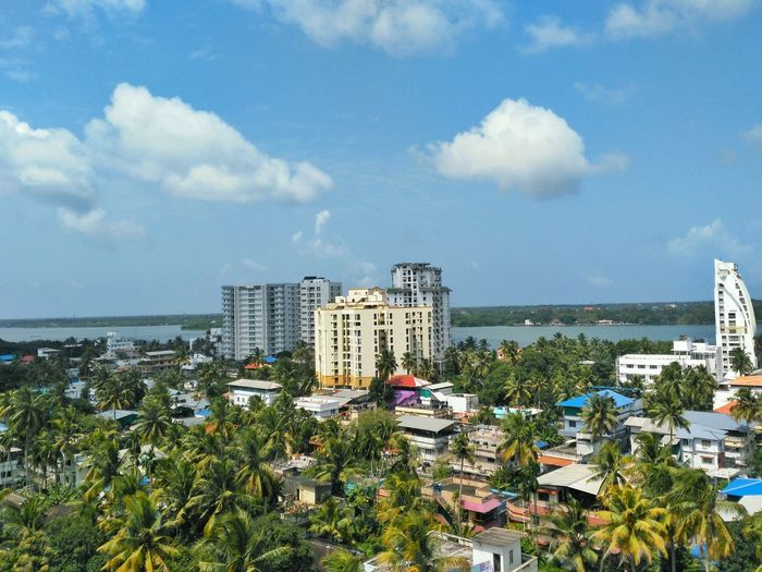 A top view of Residential buildings in Kochi, Kerala Architecture Building Exterior Built Structure Tree City Sky High Angle View Sea Blue Cityscape Growth Water Cloud - Sky Residential District Tower Cloud Skyscraper Tall - High Apartment Day Nature Scenics Travel India Outdoors