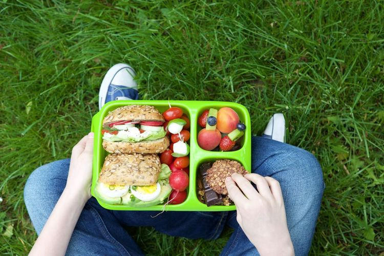 Adult Casual Clothing Day Eating Food Food And Drink Freshness Fruit Grass Green Color Healthy Eating Leisure Activity Lunch Nature Outdoors People Ready-to-eat Sandwich Sitting Two People