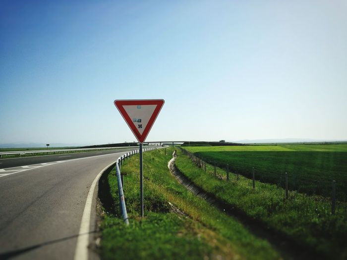 Rural Scene No People Road Landscape Agriculture Outdoors Sky Day Scenics Beauty In Nature Nature Transportation Speedway Roadtrip Roads Highway Photography Asphalt Road Road Signal Highway Give Way Give Way Signs Yield Sign Asphalt Pavement Highwayscape