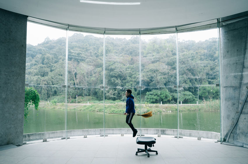 Modern wizard Adult Adults Only Day Full Length Glass Glass Wall Indoors  Leisure Activity Men Modern Nature One Man Only One Person Only Men People Real People Standing Tree Wizard Young Adult 2018 In One Photograph