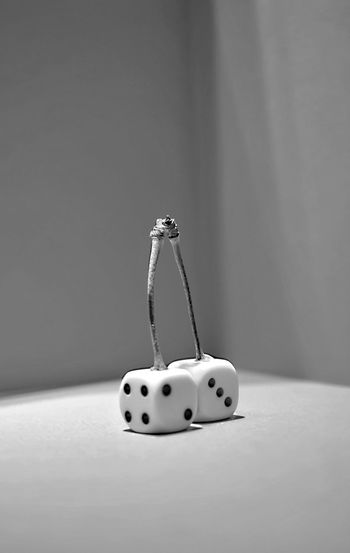 Close-up of toy on table against wall