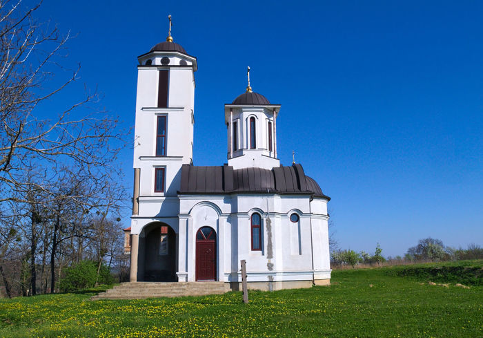 Church in Monastery complex Privina Glava, Sid, Serbia Christianity Church Hope Serbia Architecture Belief Bell Tower Blue Building Exterior Built Structure Clear Sky Cross Day Fate  Grass No People Ortodox Outdoors Place Of Worship Religion Sky Spirituality Tree