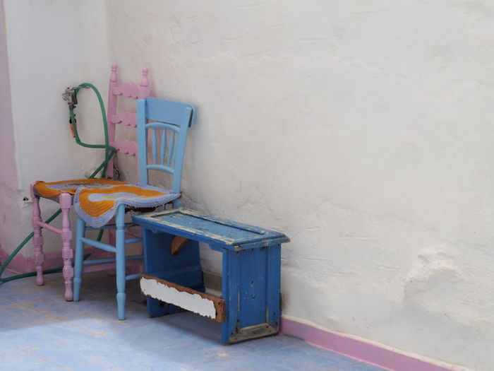 Chair And Table Against Wall