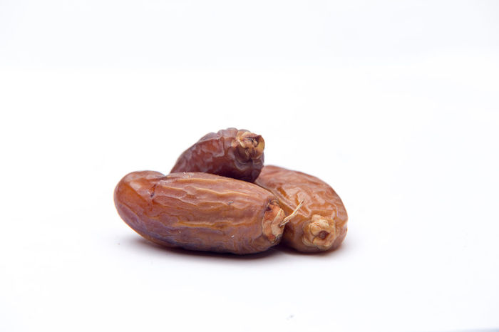 dates on white isolated background, selectibe focus Sweet Ramadhan Islam Sunnah Muslim Kurma Date Plant Pod Almond Tree Lotus Water Lily Date Palm Tree Cashew Dried Food Raisin
