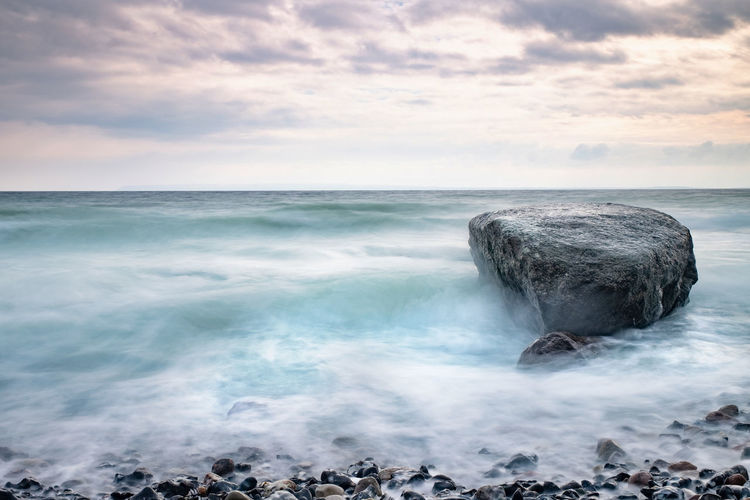 Boulders and rocks on  beach bellow kap arkona lighthouse. the popular touristic beach trail to vitt