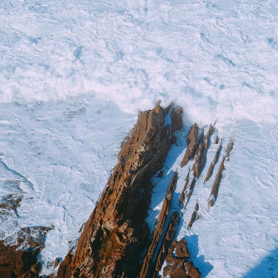 High angle view of snow covered rock formation