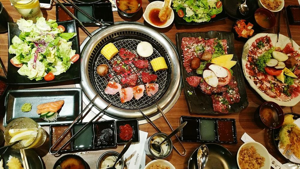 Top angle view of grilled meat in a restaurant No People Food Food And Drink Freshness Indoors  Variation Salad Grilled Meat Grill BBQ Top Angle View Restuarant Restaurant Japanese Food Korean Food Grilled Beef Grilled Pork Variety Hungry Charcoal Fire Charcoal Grilling Charcoal