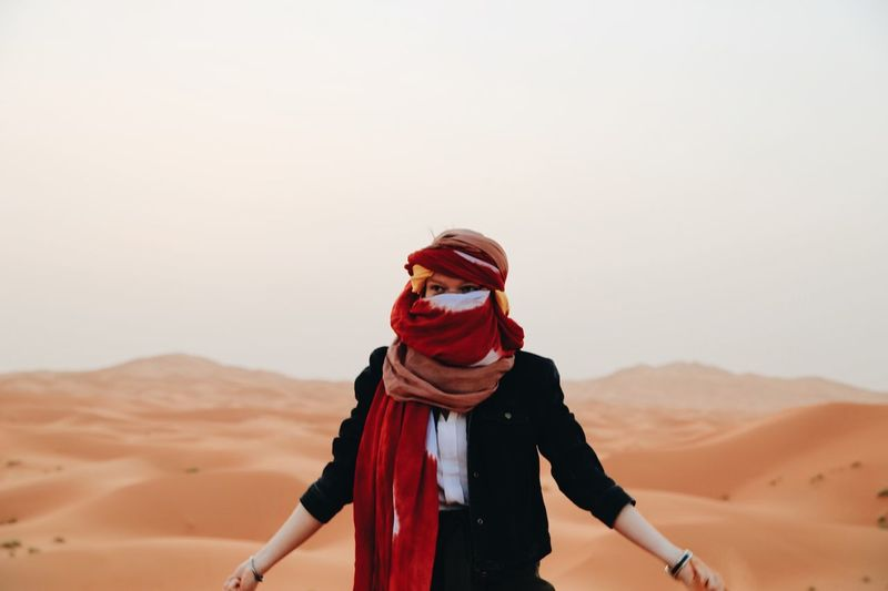 a woman in the ocean of sands. Sahara Morocco Desert One Person Land Sky Landscape Copy Space Real People Nature Leisure Activity Non-urban Scene Sand Lifestyles Climate Scenics - Nature Front View Sand Dune Glasses Environment Arid Climate Scarf My Best Photo The Great Outdoors - 2019 EyeEm Awards