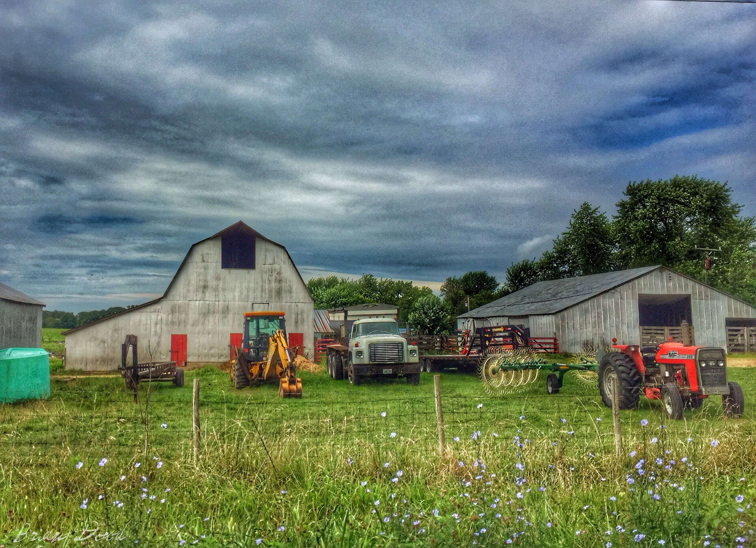sky, grass, cloud - sky, field, cloudy, building exterior, built structure, architecture, house, cloud, rural scene, farm, agriculture, landscape, green color, nature, tree, growth, grassy, transportation