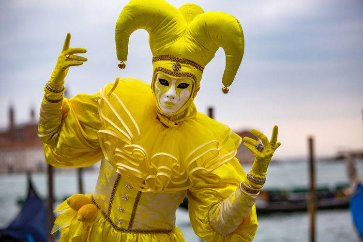 Carnival Carnival In Venice Venice, Italy Adult Carnival Masks Costume Day Focus On Foreground Gold Colored Mask - Disguise One Man Only One Person Outdoors People Religion Sky Statue Venetian Mask Yellow