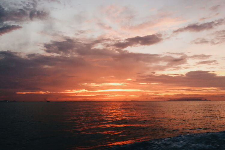 Sunset Sea Nature Scenics Seascape Cloud - Sky Horizon Over Water Beach Outdoors Dramatic Sky Beauty In Nature Water Tourism Vacations Tranquility Reflection Sky Orange Color Travel Sun