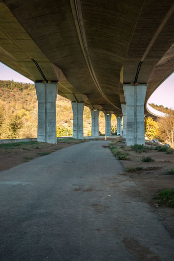 Under a big concrete bridge in Germany Architecture Transportation Road Built Structure Bridge Bridge - Man Made Structure Connection Architectural Column No People The Way Forward Day Nature Arch Tree Direction Plant Outdoors Sign Below Underneath Concrete