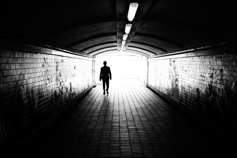 The tunnel Negative Space People Blackandwhite Monochrome Streetphotography Light And Shadow Streetphoto_bw Tunnel Light Fine Art Photography