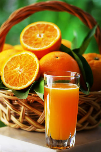 Close-Up Of Orange Juice And Fruits On Table