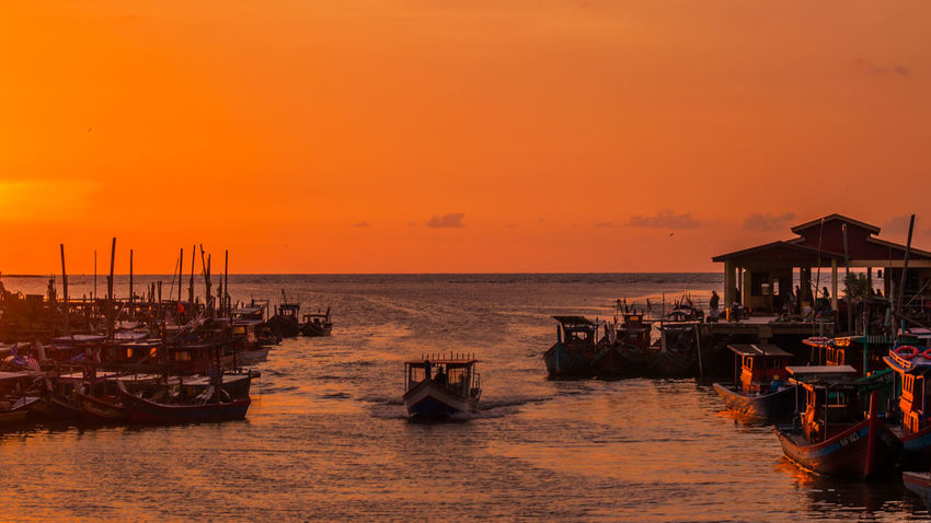 Only When Color Of Sky Fishing Village Orange Sky Sunset Collection Ambiance Color Colour Day Fishing Boat Horizon Over Water Orange Color Outdoors Scenics Sea Sunset Water