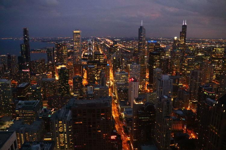 Prime - illuminated cityscape against sky at night