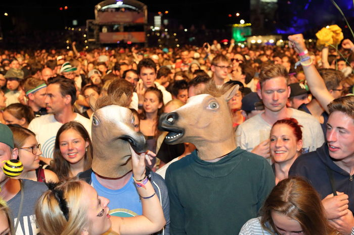frontrow crowd at Melt! Festival masked with horse heads Audience Casual Clothing City City Life Concert Concert Photography Crowd Crowded Crowds Event Festival Season Festivals Focus On Foreground Frontrow Horses Large Group Of People Long Hair Looking At Camera Mask - Disguise Music Music Brings Us Together Outdoors Togetherness Young Adult Young Women