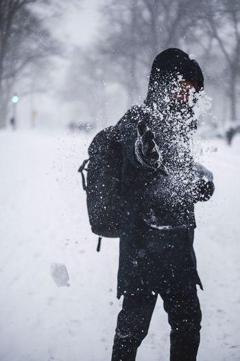 Shadow of woman standing on frozen field