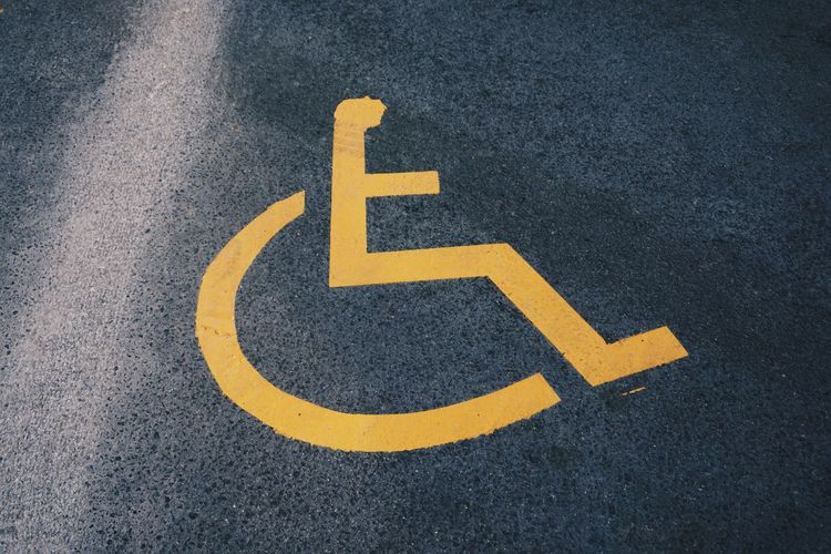 High angle view of disability sign on road