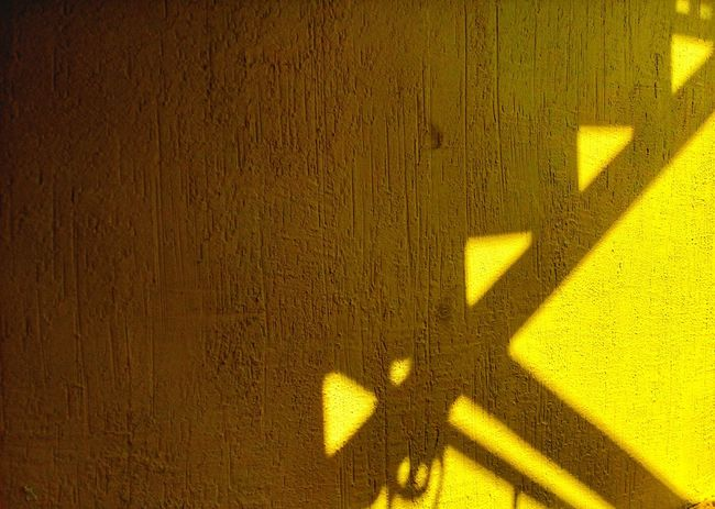 Paint The Town Yellow Shadow Backgrounds Focus On Shadow Yellow Full Frame Sunlight No People Textured  Close-up Built Structure Yellow Background MotoE Colored Background Mobile Photography Mobilephotography