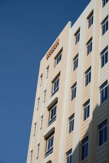 Apartment Doha Real Estate Apartment Building Exterior Architecture Built Structure Building Low Angle View Window Sky City Clear Sky Blue Nature No People Residential District Day Office Building Exterior Sunlight Outdoors Tall - High Tower Office