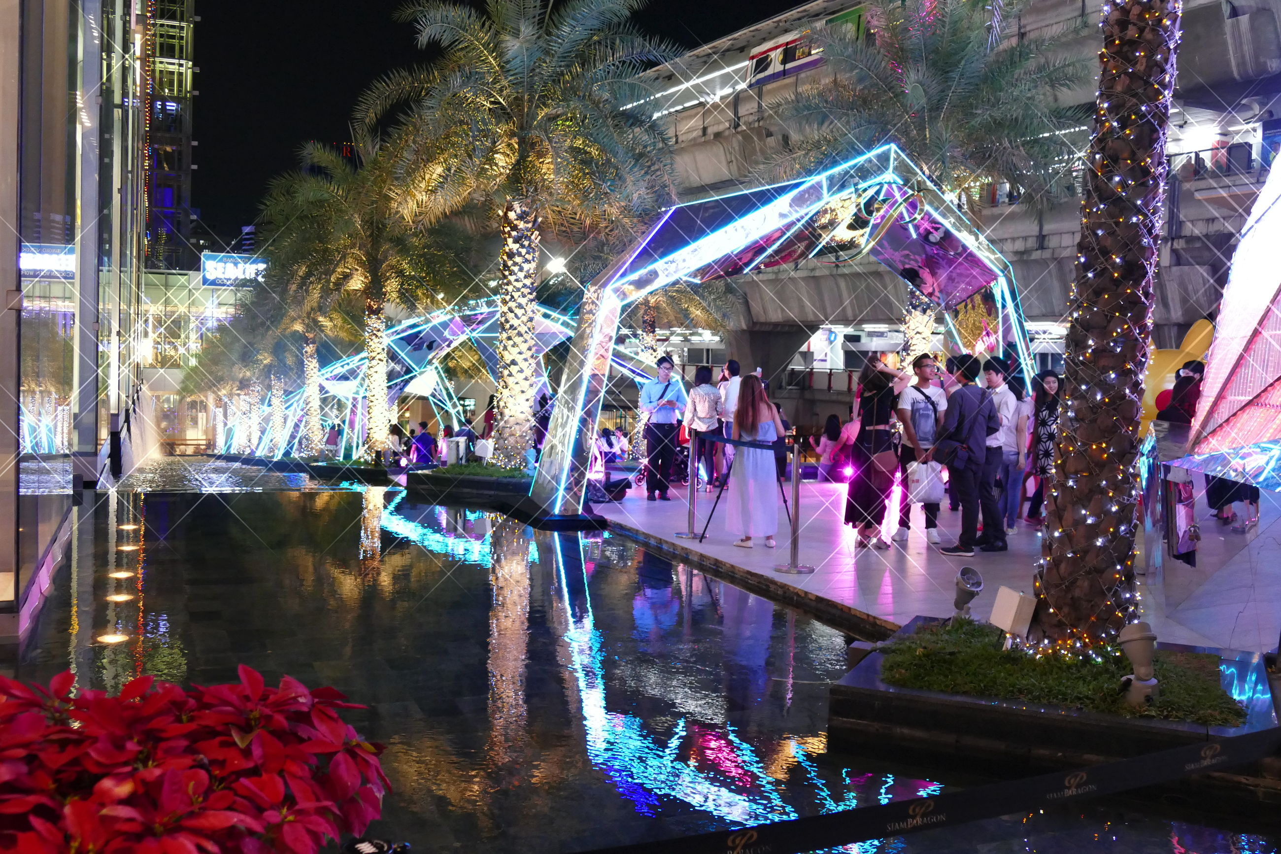 multi colored, built structure, architecture, large group of people, decoration, street, city, building exterior, reflection, water, hanging, incidental people, market, city life, tree, illuminated, outdoors, market stall, celebration, day