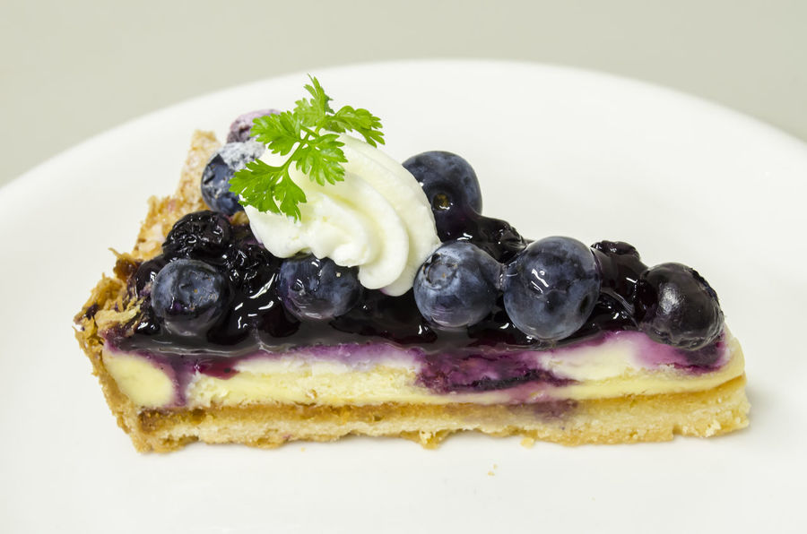Delicious Blueberry Cheese Pie Blueberry Blueberry Cheesecake Blueberry Pie Blueberrycheesecake Close-up Dessert Food Food And Drink Freshness Fruit Indoors  Indulgence No People Plate Ready-to-eat Serving Size SLICE Sweet Food Temptation