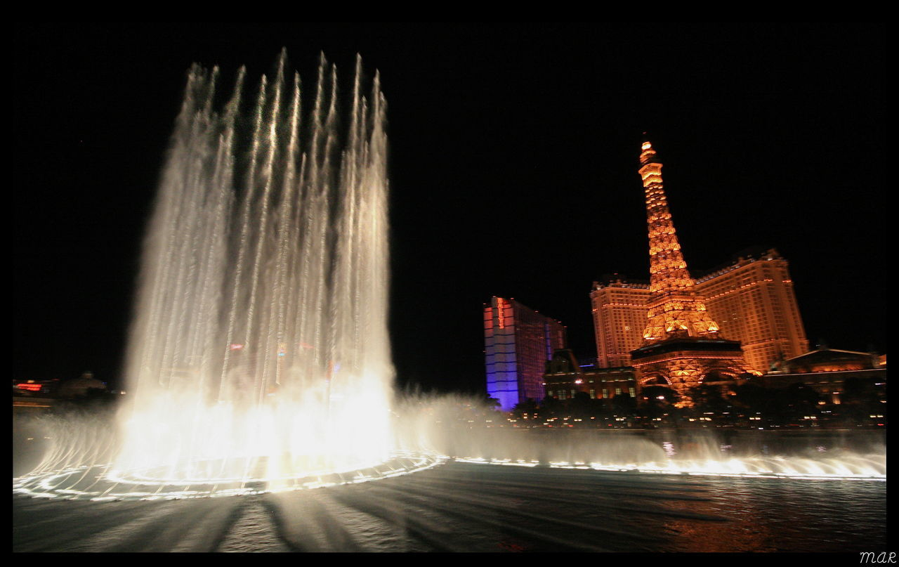 night, architecture, built structure, illuminated, travel destinations, building exterior, fountain, water, sky, spraying, motion, tourism, city, travel, long exposure, nature, building, tower, no people, skyscraper, luxury