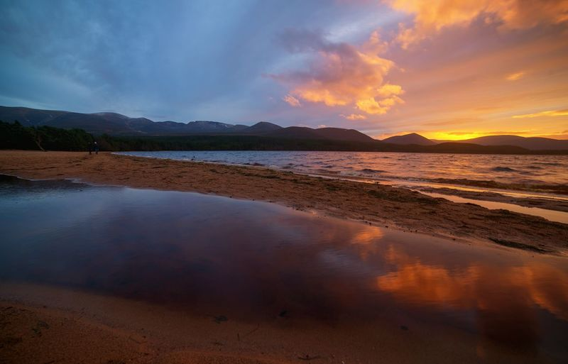 loch morlich, scotland Beach Reflection no people Sunset Mountain Scenics Nature Extreme Weather Outdoors Beauty In Nature Eyeemphoto My Year My View Light And Shadow EyeEm MasterclassLake Dramatic Sky Dark Beauty Today's Hot Look Silhouette Landscape