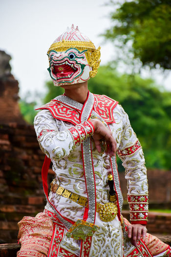 Man in traditional clothing dancing outdoors