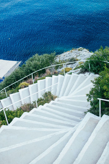 High angle view of steps by swimming pool